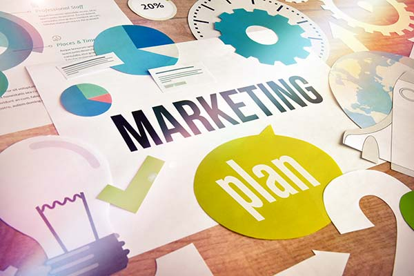marketing plan collage on a table